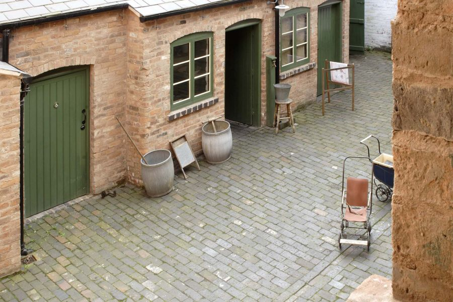 A view of the Courtyard at the Birmingham Back to Backs from an upstairs window. Court 15 contained eleven houses with shared facilities such as the laundry and outside lavatories.