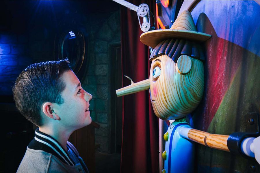 A visitor enocunters Pinocchio at Shrek's Adventure! London.Photo: Mikael Buck.Copyright: Merlin Entertainments. All Rights Reserved.