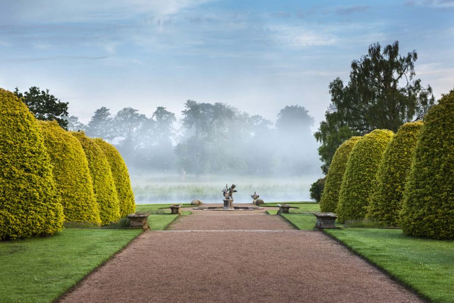 The garden terraces in June on a misty morning on the Shugborough Estate, Staffordshire.