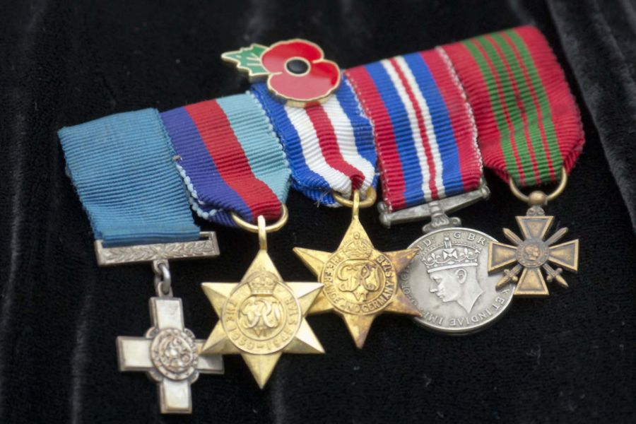 Violette Szabo's medals worn by her daughter Tania at a Service of Dedication where the Prince of Wales unveiled a memorial to honour and remember the women who flew out of RAF Tempsford to aid resistance movements in occupied Europe he met relatives and members of the local community at The Wheatsheaf public house, Tempsford, Bedfordshire.