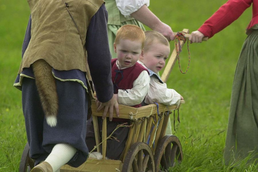 Twins Morgan (left) and Lewis King,  aged two, from Caerphilly south Wales play their part with the Sealed Knot in the re-enactment of the Siege of Bristol, 1643-1644, at Weston-super-Mare on Bank Holiday.