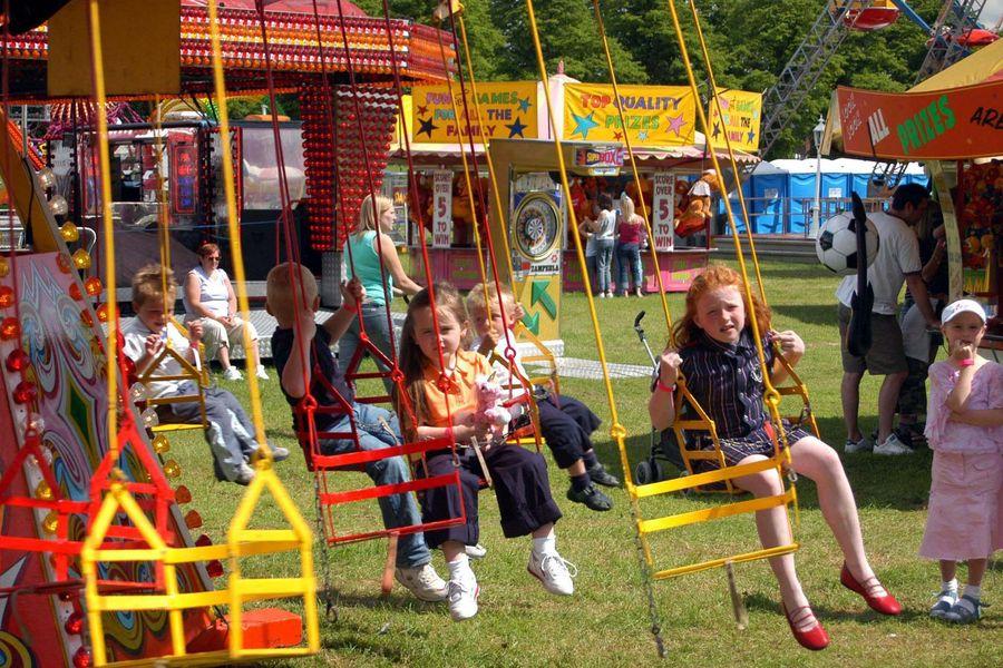 Children enjoy one of the rides at the fairground on York racecourse.