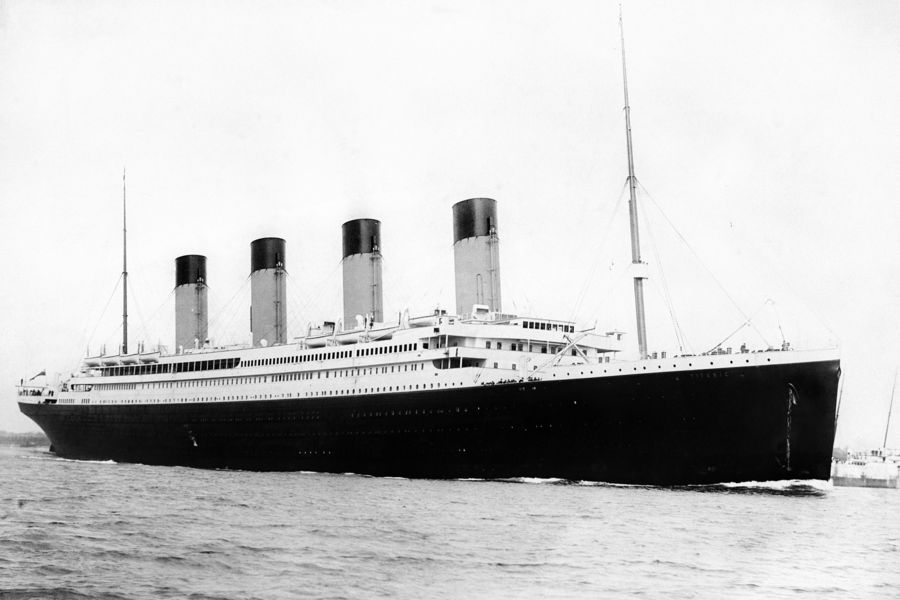 """A photograph c1912 of the """"unsinkable"""" four-funnelled ship the RMS Titanic. Part of the White Star Line, Titanic sank off Newfoundland on her maiden voyage to the USA after striking an iceberg (14-15/4/1912). 1513 people lost their lives.   *02/04/02The SS Titanic. The City of Belfast will pay tribute to the man who designed its most famous ship, the Titanic, Tuesday April 02, 2002. Lord Mayor Jim Rodgers will unveil a plaque at the former home of Thomas Andrews, 90 years to the day that the ship left Belfast for Southampton to begin its ill-fated maiden voyage. Commissioned by the Ulster History Circle, the plaque will be unveiled at the house now occupied by the Irish Football Association at Windsor Avenue in south Belfast. A series of events have been taking place in Belfast as part of a festival to commemorate the 90th anniversary of the launch of the Titanic.  02/12/03: A manuscript which describes the final hours of the Titanic by the most senior officer to survive the sinking was today, being auctioned at Sotheby's New Bond Street sale rooms in London. The 17-page unpublished document by Charles Lightoller, the vessel's Second Officer, was going under the hammer with other memorabilia relating to the famous ship."""