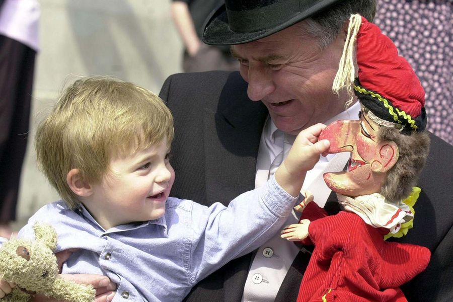 Two-year-old George Martin from Battersea, south London grabs Mr Punch by the nose, while puppet-master Tom Suddes looks on, during the 26th Annual Covent Garden May Fayre and Puppet Festival in London.  *  The fair comemorates the first Punch and Judy show seen in London by Samuel Pepys in May 1662.   21/10/04: Punch and Judy shows could be banned by a Bodmin Town council in Cornwall Thursday October 21, 2004. The move follows a protest after they were shown to children during the summer holidays. The show  which has its origins in 16th century Italy features Mr Punch whacking Mrs Punch with a stick.