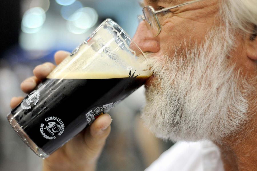 A man drinks real ale during the first day of the Campaign For Real Ale (CAMRA) Great British Beer Festival at Earl's Court, London.